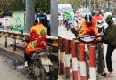 Chùm ảnh : Người Hà Nội mặc áo mưa, khoác chăn bông xuống phố tránh rét